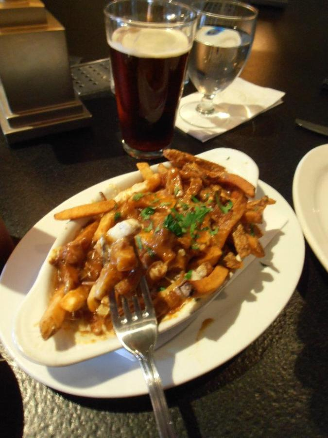 Poutine! French fries, gravy, and cheese curds. A Canadian staple on a Boston menu.