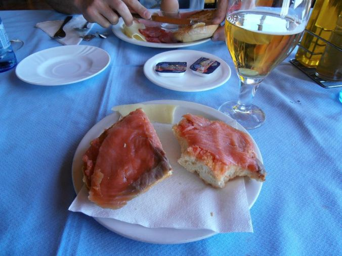 Breakfast. Toasted bread rubbed with olive oil and tomatoes with salty salmon on top....and beer of course. It's a vacation after all.