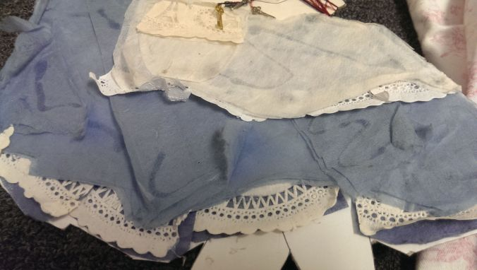 I glued some thin cloth-like paper to make her dress and cut up paper doilies to make her lacey  undergarment.